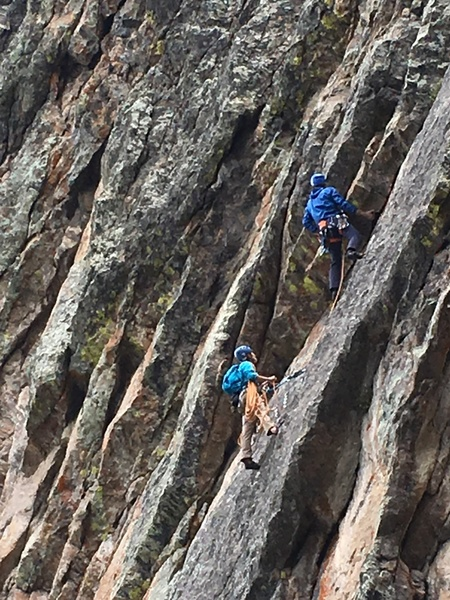 Dan working the opening overlap moves at the beginning of pitch 2 with Lauren belaying from the anchors on Riding with the Ravens.