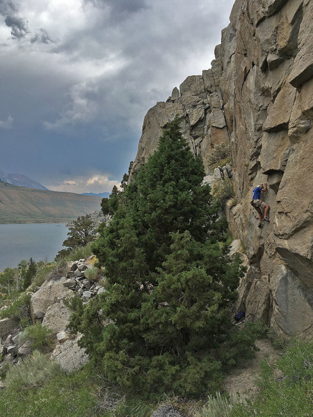 andy s. on the technical crux of the route.  note that he placed a small cam under the little lip between the 1st and 2nd bolt.