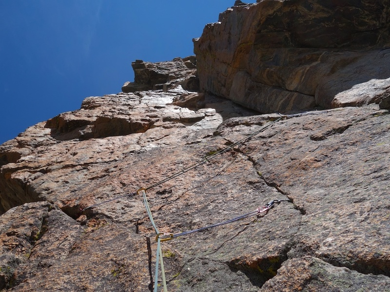 Pitch 3. Go left from belay, then ascend up face with thin cracks, and climb the left-facing corner above.