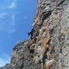 Pitch 4. Awesome exposure as you go left around the arete.