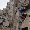 andy s. starting the physical crux of the route - big holds on overhanging rock