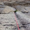 The top of pitch 1, the R section. It feels like you are a ways from your last piece, but the climbing is 5.8....