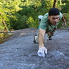 Derek on the final moves of the slab on And Say (Lookout Point area)
