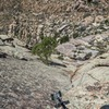 Looking down from top of p2 to my second at the p1 belay station (belayed in the gully below the ledges)