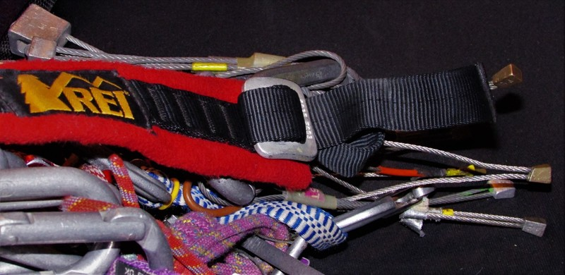 REI  Adjustable Gear sling, Full strength buckle, Always check the 'tail'