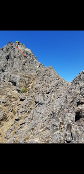 This is looking toward the summit ridge from just past the top of P10b anchors. The red line shows the correct route to the p11b anchors. I did not take this line so I do not know if there are bolts on the route or not.