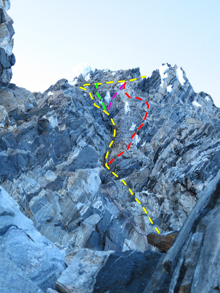 View of the SE Chimneys during evening rappel. Yellow = normal route (exit left after second chockstone, cross back right above). Red = Right hand variation (exit right below first chockstone; best option when dry). Green = direct exit (5.8 or A0). Purple