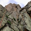Nearing the final (8th) bolt and the crux.<br> <br> Photo by Jay Patterson.