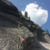 leading up the dirty ramp on the final pitch. (The anchor pictured is next to the standard route 100 ft from the top.)