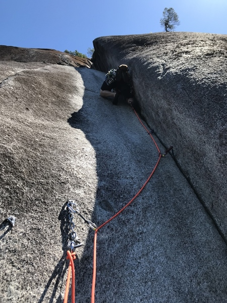 Me questing up the 5.8 crack pitch, after climbing a number of corner cracks in my time it feels comparable to like 5.10b.