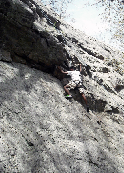 Climber on Overhang Notch route.