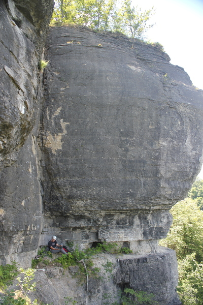 Just before the first ascent Ben Watrous preps gear during the development phase (2015-2017) prior to public opening, the greenery on the ledge has been cleaned up since then.