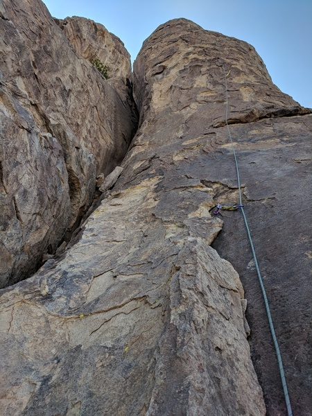 Looking up at the buttress from the route start (top of Alice in Bananaland)