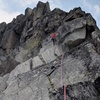 The first rappel, from just below the summit block, down the North Ridge.