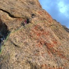 Tricky traverse on the final pitch. The dihedral out right leads to moderate climbing to the summit.