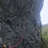 Liam feels the exposure on the P3 traverse! Note the intermediate belay I am at, you cant see it until you're face to face with it.