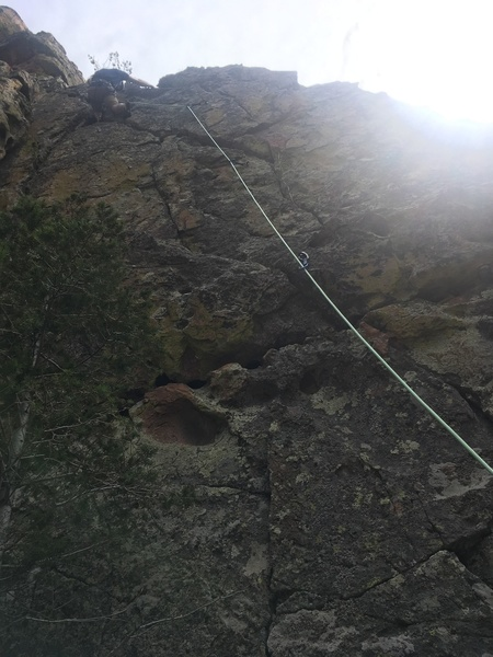 """Alex at the top of """"N"""". The rope follows the route line. The anchors are shared with """"O"""" to the left."""