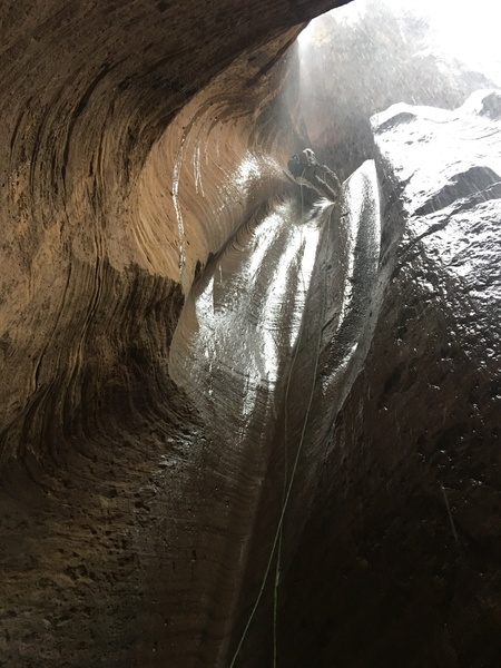 Zion NP, caught canyoneering in the rain, right before the flash.