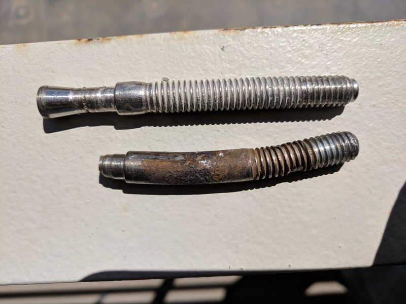 The original bent crux roof bolt that was replaced compared to an undamaged stud. A beefy glue-in now protects crux.