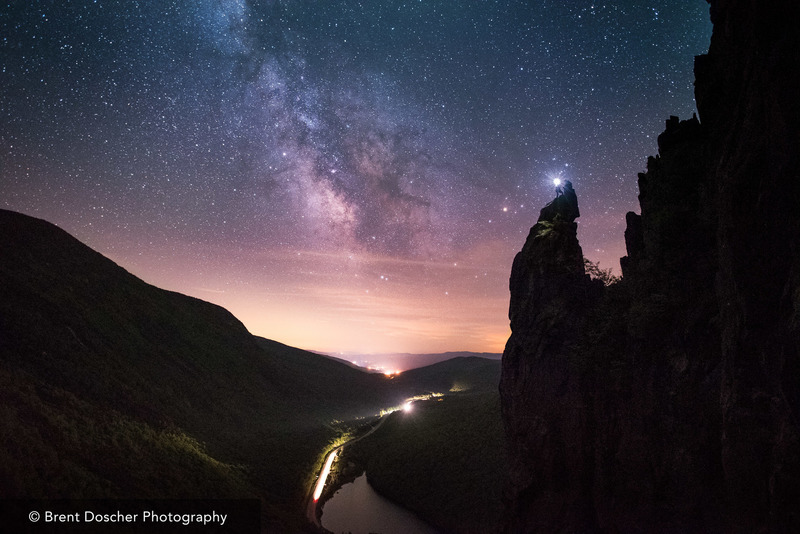 Climbers atop The Eaglet as the milky way rises over the notch