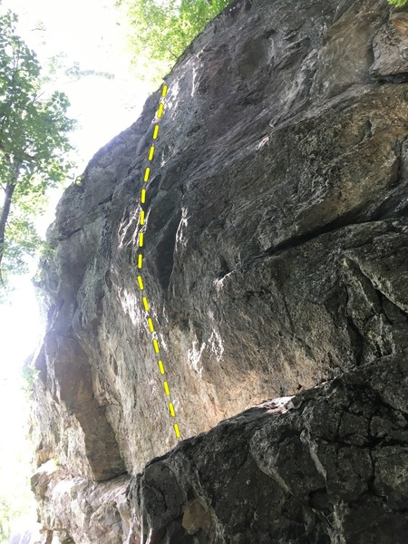 The steep wall above the ledge