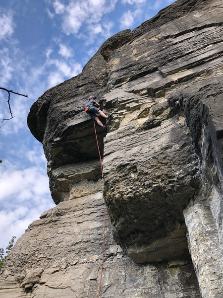 Rock is crumbly right of climber's feet.
