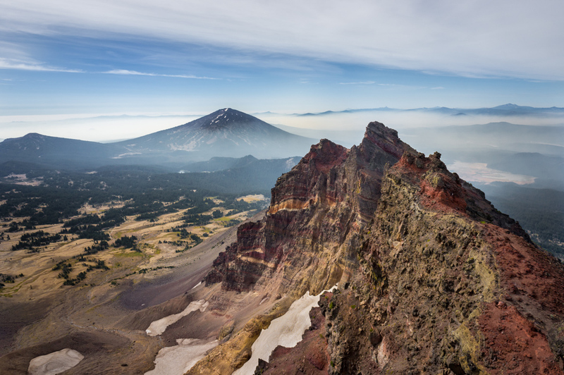 A view of the south from the peak of Broken Top, haze/smoke included during the summer of 2018.  Featured:  southern half of Broken Top and Mt Bachelor