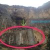 Wall below a cave.
