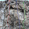 Yellow: Private Idaho, 5.9 trad<br> Red: Colossus, 5.10c, sport<br> Blue dashed: Wild Country, 5.11b, trad<br> Blue solid: Tarantula, 5.11c/d, sport<br> Green: Loch Ness Monster, 5.11c, sport