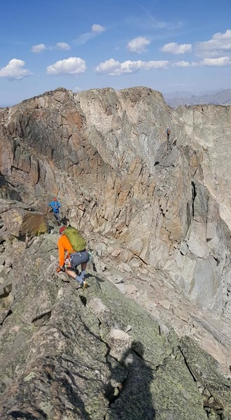 Starting the exposed section of ridge heading towards the rappel.