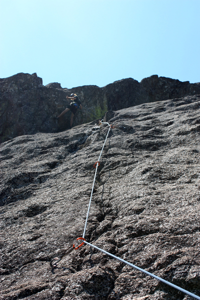 HangTen, Pitch 2. Daniel Scott on the crux headwall. A longer sling on first bolt in photo would help reduce drag.