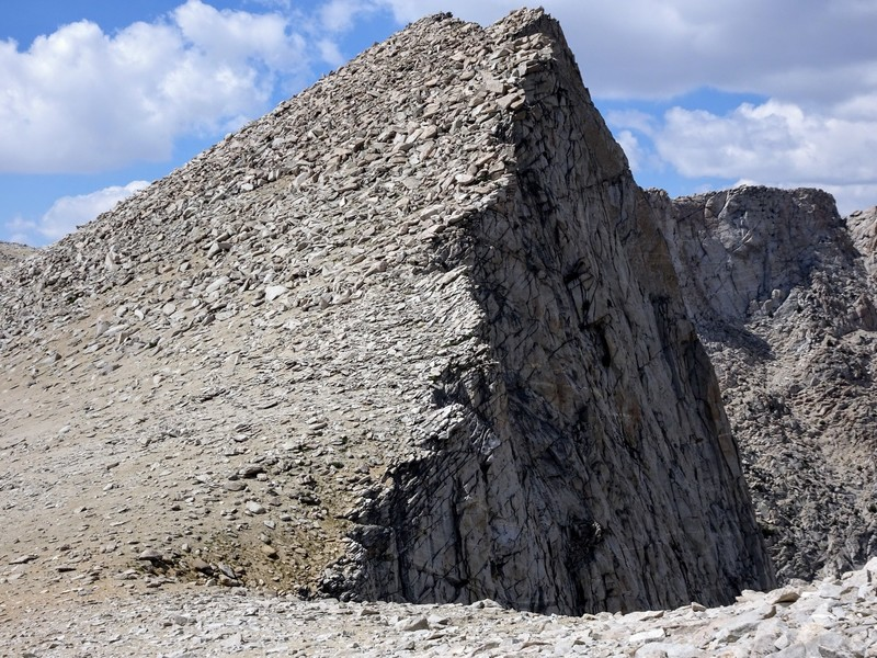 """Four Gables South as seen from the long tedious descent. The summit plateau of """"Four Gables"""" can be seen to the right."""