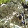 Steve E. standing next to one of the lower walls/boulders in the Outlying Area. Just below the power line clearing. Steve is just over 6 feet tall