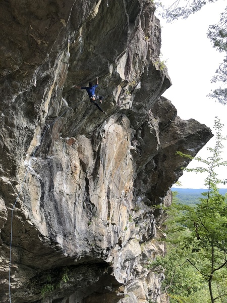 Me, cutting feet on the Crux during the send.