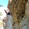 Michael Bratcher on the first bulge on the route's FA.