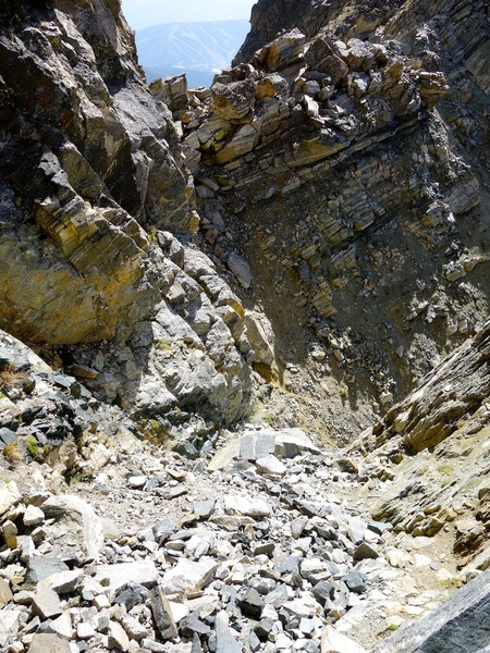 Descent gully. Descend straight west, then cut left to notch and go down that gully alongside south face.