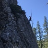 Lou halfway down from cleaning the route. Long slings at the top are helpful if setting a top rope!
