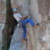 "Jonas Abdo on the initial boulder problem of ""Crack of Doom"" (5.11c). Photo by John Baumchen."