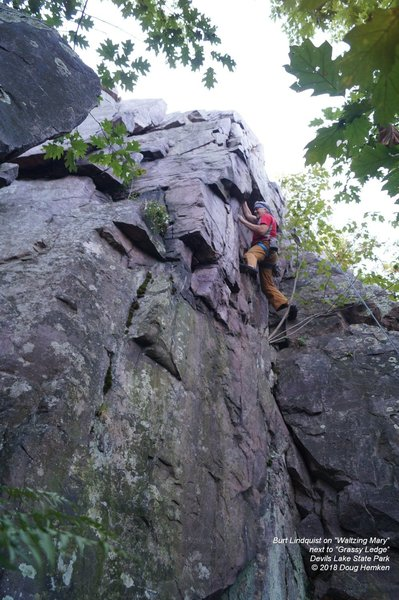 """""""Grassy Ledge"""" starts on the outside corner left of the climber."""