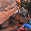 Jonah Small getting the first ascent on campus crack. Once you get the mantle, you reach up to the small crimp. (like so)