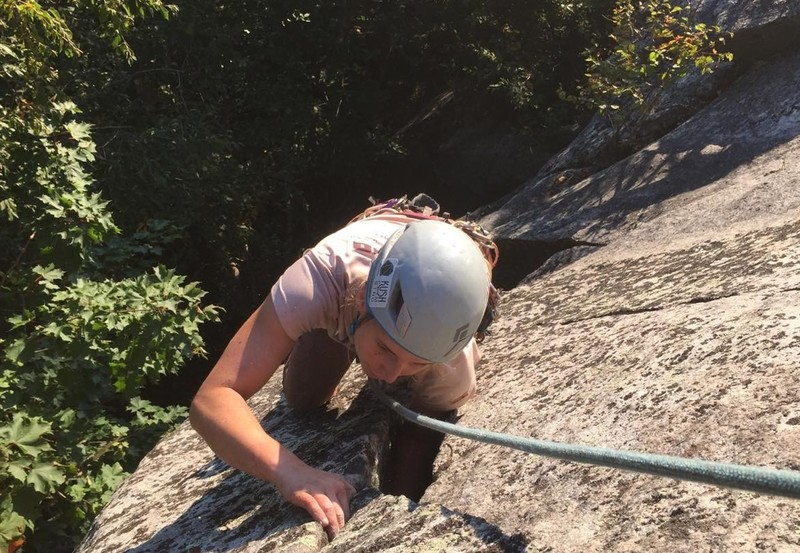 Josie pulling out of the offwidth and into the last couple moves of the climb