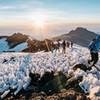 Luke Gamblin summiting Mt. Kilimanjaro, 6:30am, August 2018.