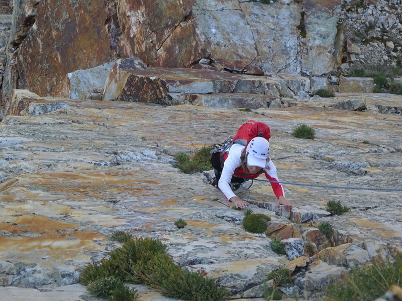 Shari having a great time at age 68 while cruising up the almost vertical face of P4 of Eleventh Hour on 09-04-17.