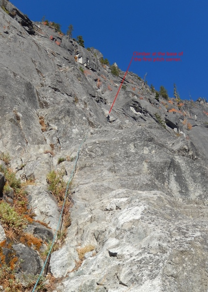 One of the 3rd class approach to the first pitch. Start from the obvious weakness in the rock (an open corner with bushes) follow a 3rd class ramp right and up to a clean corner, the start the real climbing of the first pitch. Set up your initial belay at