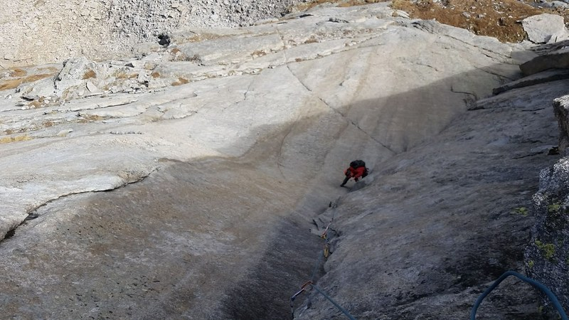 Looking down on Eye of Mordor pitch with scary 5.8 friction seam just below the climber in the photo.