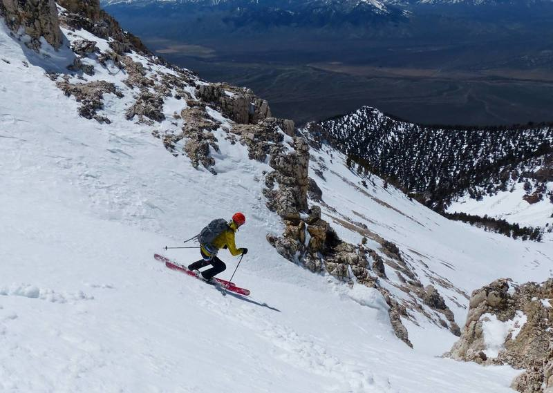 Dean Lords lining up the final chute on the (possible? unknown) first ski descent of West Face.