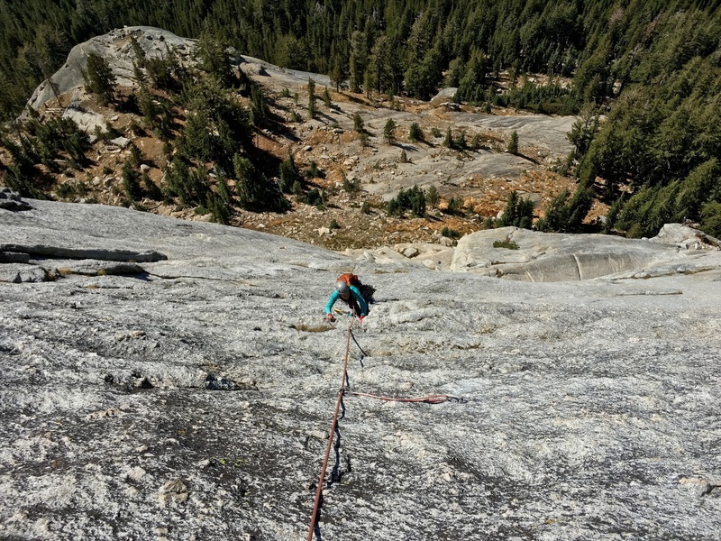 Giselle climbs up to the top of pitch 3. Very featured rock here.