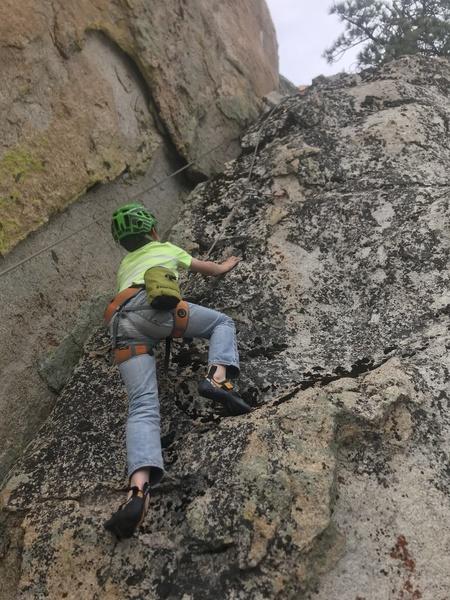 Stephen Owen climbing.