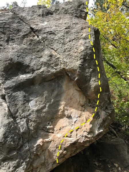 Climb up right through left-hand two finger pocket finish up right arete