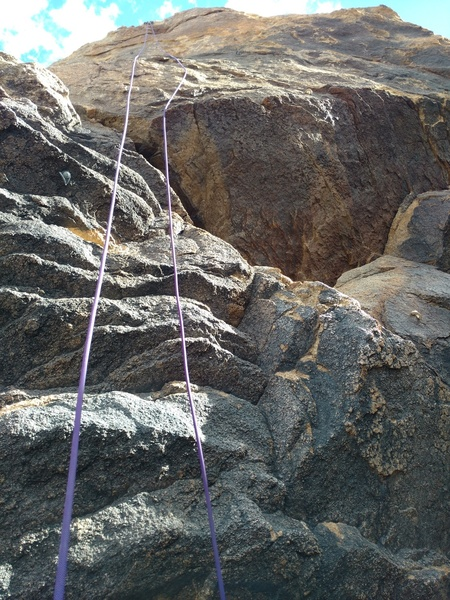 Rope runs over the 5.9 to the left of the 5.10a's bolts